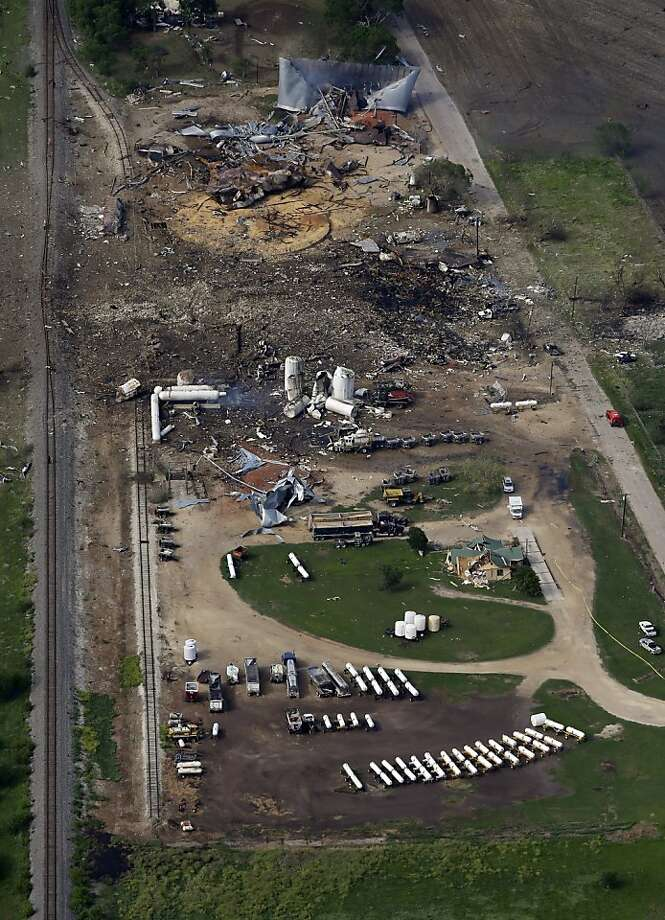This aerial photo shows the remains of a fertilizer plant destroyed by an explosion in West, Texas, Thursday, April 18, 2013. A massive explosion at the West Fertilizer Co. killed as many as 15 people and injured more than 160, officials said overnight. The explosion that struck around 8 p.m. Wednesday, sent flames shooting into the night sky and rained burning embers and debris down on shocked and frightened residents. (AP Photo/Tony Gutierrez) Photo: Tony Gutierrez, Associated Press