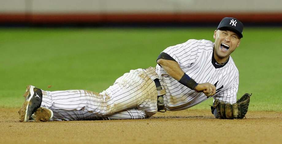FILE - In this Oct. 14, 2012 file photo, New York Yankees shortstop Derek Jeter reacts after injuring himself in the 12th inning of Game 1 of the American League championship series against the Detroit Tigers in New York. Yankees captain Derek Jeter has left the team's minor league complex in Florida where he was rehabbing his injured ankle and gone for a medical exam. (AP Photo/Paul Sancya, File) Photo: Paul Sancya