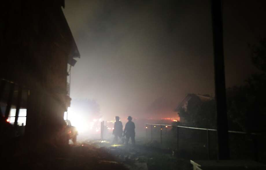 AP10ThingsToSee - Firefighters search an area destroyed by a fertilizer plant explosion in West, Texas, early Thursday morning, April 18, 2013.  (AP Photo/LM Otero) Photo: LM Otero, Associated Press