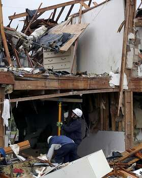 Firefighters set a brace to hold up a sagging beam during a search and rescue operation at an apartment complex destroyed by an explosion at a fertilizer plant in West, Texas, Thursday, April 18, 2013.  A massive explosion at the West Fertilizer Co. killed as many as 15 people and injured more than 160, officials said overnight.  The explosion that struck around 8 p.m. Wednesday, sent flames shooting into the night sky and rained burning embers and debris down on shocked and frightened residents.  (AP Photo/Tony Gutierrez) Photo: LM Otero, Associated Press