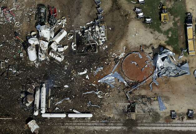 This aerial photo shows the remains of a fertilizer plant destroyed by an explosion in West, Texas, Thursday, April 18, 2013. A massive explosion at the West Fertilizer Co. killed as many as 15 people and injured more than 160, officials said overnight. The explosion that struck around 8 p.m. Wednesday, sent flames shooting into the night sky and rained burning embers and debris down on shocked and frightened residents. (AP Photo/Tony Gutierrez) Photo: Tony Gutierrez, Associated P