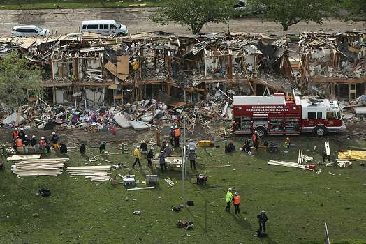 WEST, TX - APRIL 18:  Search and rescue workers comb through what remains of a 50-unit apartment building the day after an explosion at the West Fertilizer Company destroyed the building April 18, 2013 in West, Texas. According to West Mayor Tommy Muska, around 35 people, including 10 first responders, were killed and more than 150 people were injured when the fertilizer company caught fire and exploded, leaving damaged buildings for blocks in every direction.  (Photo by Chip Somodevilla/Getty Images) Photo: Chip Somodevilla, Getty Images