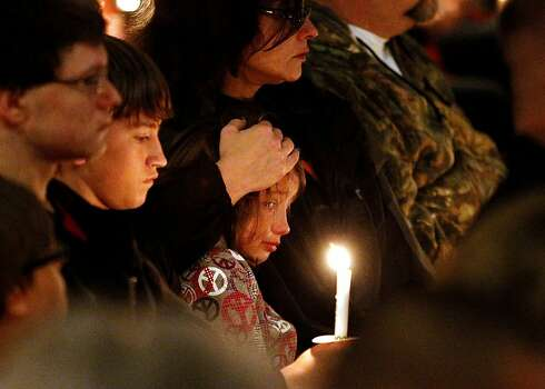 The people of West, Texas, during a candlelight vigil on Thursday, April 18, 2013, for victims, families, friends and first responders near the scene of the fertilizer plant that exploded Wednesday night. (Ron Jenkins/Fort Worth Star-Telegram/MCT) Photo: Ron Jenkins, McClatchy-Tribune News Service