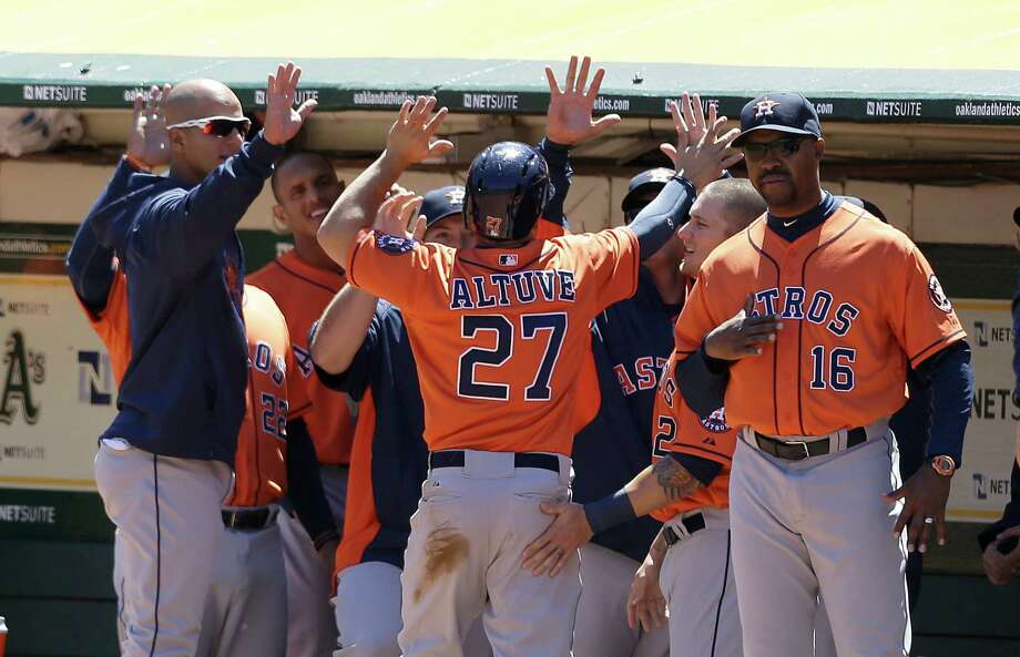 If the Astros have had any reason to celebrate offensively this season, Jose Altuve (27) was most likely involved. But few of his teammates have consistently provided much help to go along with his .365 batting average. Photo: Jeff Chiu, STF / AP