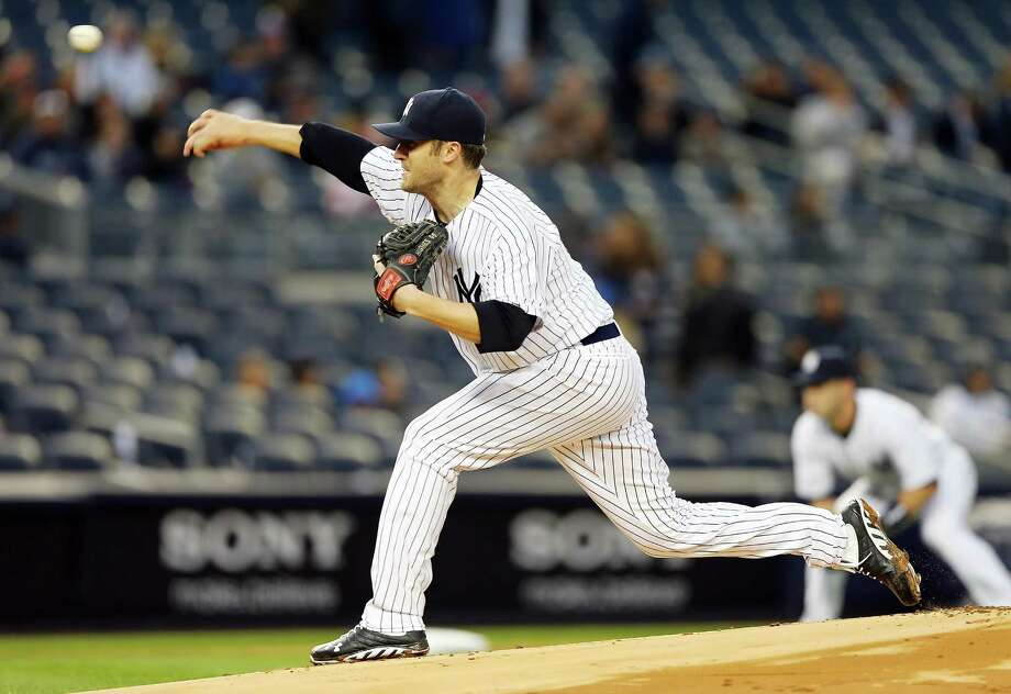 NEW YORK, NY - APRIL 18:  Phil Hughes #65 of the New York Yankees delivers a pitch in the first inning against the Arizona Diamondbacks on April 18, 2013 at Yankee Stadium in the Bronx borough of New York City.  (Photo by Elsa/Getty Images) Photo: Elsa