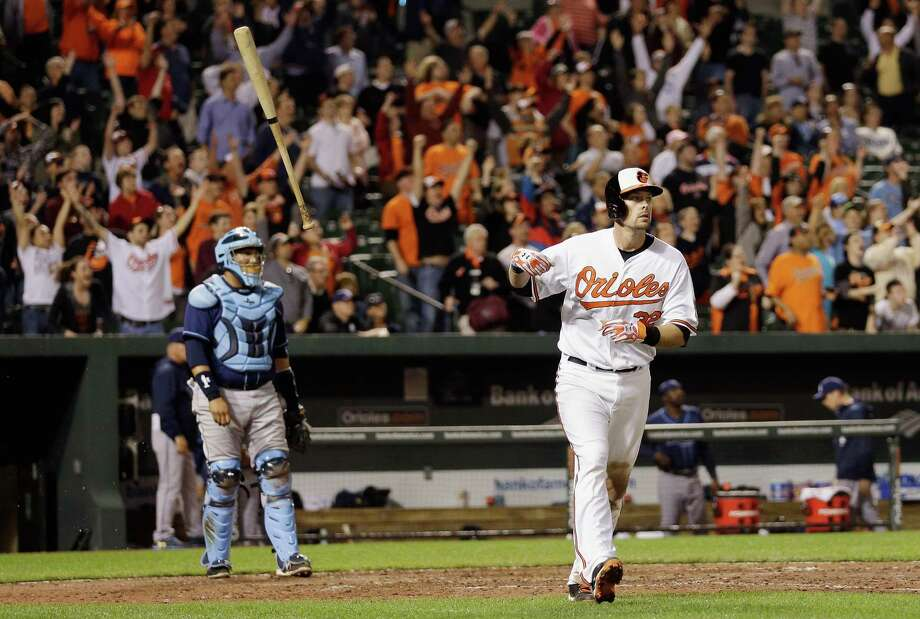 Matt Wieters starts his stroll on a walk-off grand slam in the 10th inning. Photo: Rob Carr, Staff / 2013 Getty Images