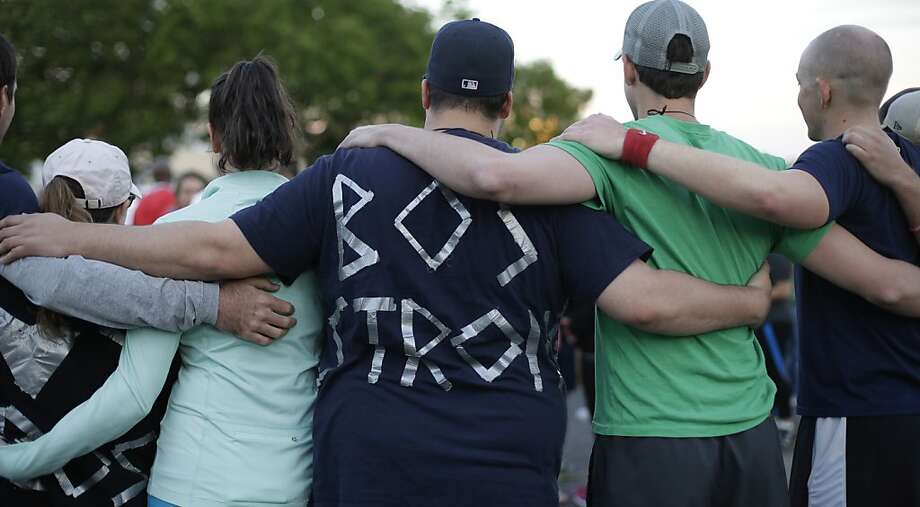 Runners take part in a memorial service and run to honor Boston Marathon victims, in Austin, Texas, Thursday, April 18, 2013. (AP Photo/Eric Gay) Photo: Eric Gay, Associated Press