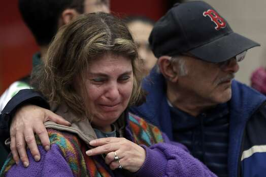 Bob Cohen holds his wife Joyce as they pay their respects at a makeshift memorial near the finish line of Monday's Boston Marathon explosions, which killed at least three and injured more than 140, Thursday, April 18, 2013, in Boston. (AP Photo/Matt Rourke) Photo: Matt Rourke, Associated Press