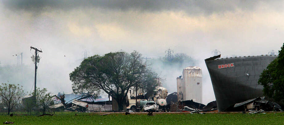 Smoke rises Thursday from an area where an explosion took place at the West Fertilizer Company. In the light of day, destruction from the night before was starkly evident in West and its surroundings.