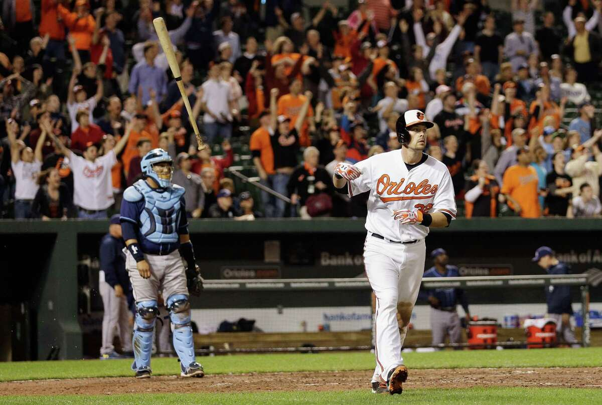 Rays catcher Jose Molina only can watch as Matt Wieters' grand slam won it for the Orioles.