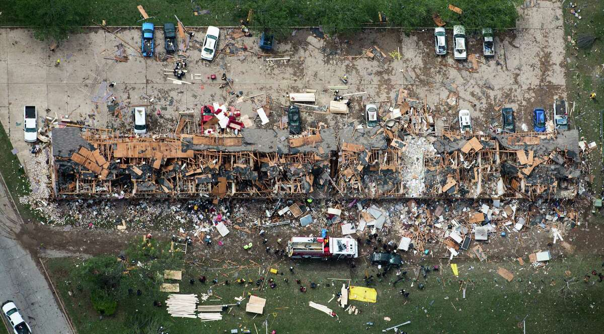 Rescue crews search a destroyed apartment complex near the fertilizer plant. Three schools within a half-mile of the plant also had significant damage.