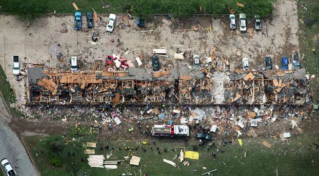 Rescue crews search a destroyed apartment complex near the fertilizer plant. Three schools within a half-mile of the plant also had significant damage. Photo: Smiley N. Pool / Houston Chronicle