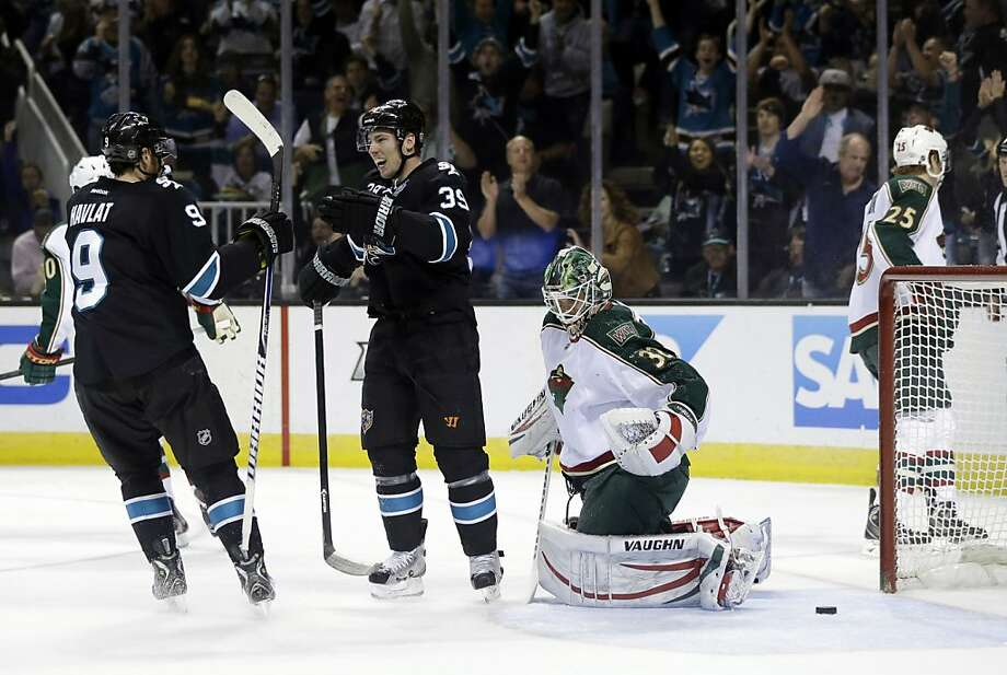 Martin Havlat (left) celebrates his goal with Logan Couture in front of goalie Niklas Backstrom. It was the first of four goals the linemates would score. Photo: Marcio Jose Sanchez, Associated Press