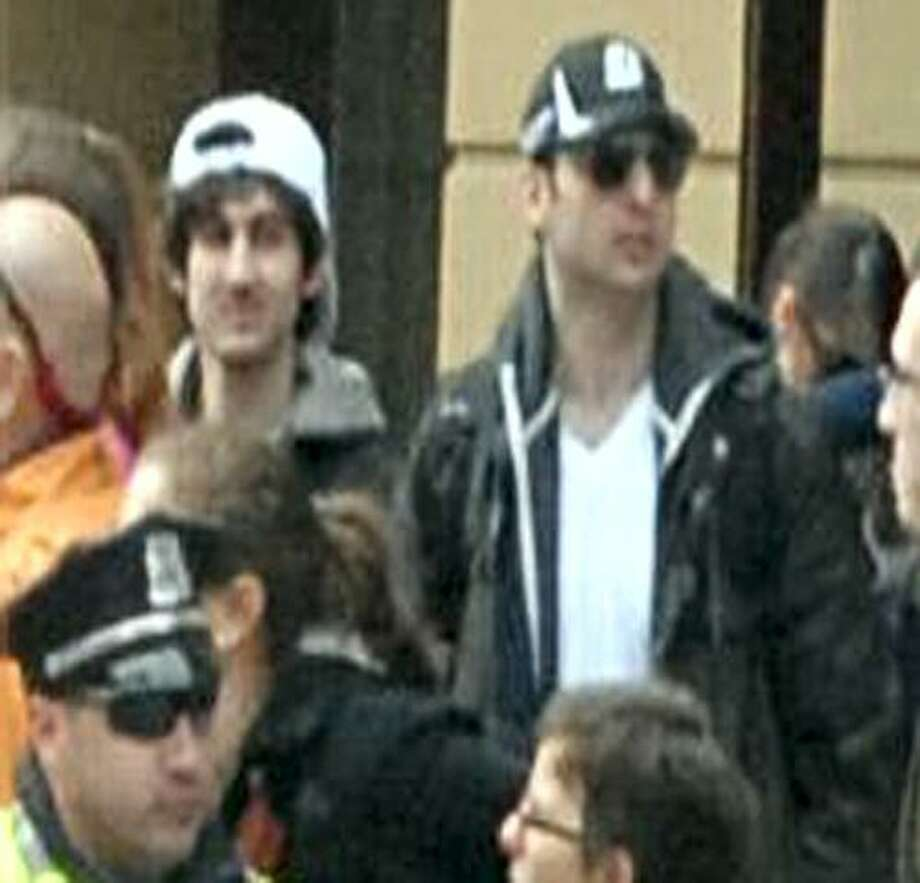 In this image released by the Federal Bureau of Investigation on April 19, 2013, two suspects in the Boston Marathon bombing walk near the marathon finish line on April 15, 2013, in Boston.