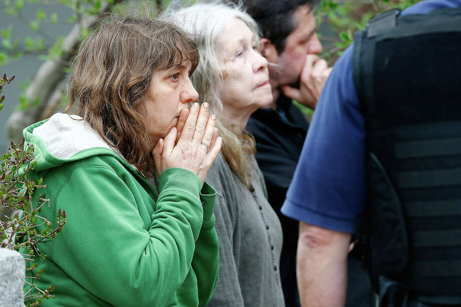 A woman reacts while being questioned by the FBI and other law enforcement agencies on April 19, 2013 near the home of suspect #2 on Norfolk Street in Cambridge, Massachusetts. Earlier, a Massachusetts Institute of Technology campus police officer was shot and killed late Thursday night at the school's campus in Cambridge. A short time later, police reported exchanging gunfire with alleged carjackers in Watertown, a city near Cambridge. According to reports, one suspect has been killed during a car chase and the police are seeking another - believed to be the same person (known as Suspect Two) wanted in connection with the deadly bombing at the Boston Marathon earlier this week. Police have confirmed that the dead assailant is Suspect One from the recently released marathon bombing photographs. Photo: Jared Wickerham, Getty Images / 2013 Getty Images