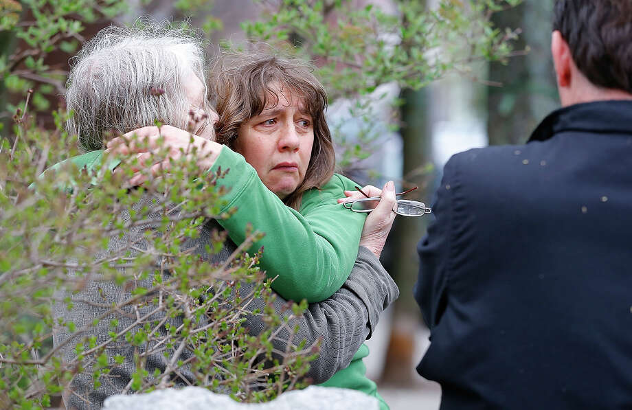 A woman reacts while being questioned by the Cambridge Police and other law enforcement agencies on April 19, 2013 near the home of suspect #2 on Norfolk Street in Cambridge, Massachusetts. Earlier, a Massachusetts Institute of Technology campus police officer was shot and killed late Thursday night at the school's campus in Cambridge. A short time later, police reported exchanging gunfire with alleged carjackers in Watertown, a city near Cambridge. According to reports, one suspect has been killed during a car chase and the police are seeking another - believed to be the same person (known as Suspect Two) wanted in connection with the deadly bombing at the Boston Marathon earlier this week. Police have confirmed that the dead assailant is Suspect One from the recently released marathon bombing photographs. Photo: Jared Wickerham, Getty Images / 2013 Getty Images