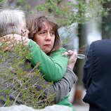 WATERTOWN, MA - APRIL 19: A woman reacts while being questioned by the Cambridge Police and other law enforcement agencies on April 19, 2013 near the home of suspect #2 on Norfolk Street in Cambridge, Massachusetts. Earlier, a Massachusetts Institute of Technology campus police officer was shot and killed late Thursday night at the school's campus in Cambridge. A short time later, police reported exchanging gunfire with alleged carjackers in Watertown, a city near Cambridge. According to reports, one suspect has been killed during a car chase and the police are seeking another - believed to be the same person (known as Suspect Two) wanted in connection with the deadly bombing at the Boston Marathon earlier this week. Police have confirmed that the dead assailant is Suspect One from the recently released marathon bombing photographs.