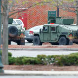 WATERTOWN, MA - APRIL 19: Military Police arrive in armoured vehicles at the parking lot of the Arsenal Mall on April 19, 2013 in Watertown, Massachusetts. Earlier, a Massachusetts Institute of Technology campus police officer was shot and killed late Thursday night at the school's campus in Cambridge. A short time later, police reported exchanging gunfire with alleged carjackers in Watertown, a city near Cambridge. According to reports, one suspect has been killed during a car chase and the police are seeking another - believed to be the same person (known as Suspect Two) wanted in connection with the deadly bombing at the Boston Marathon earlier this week. Police have confirmed that the dead assailant is Suspect One from the recently released marathon bombing photographs.