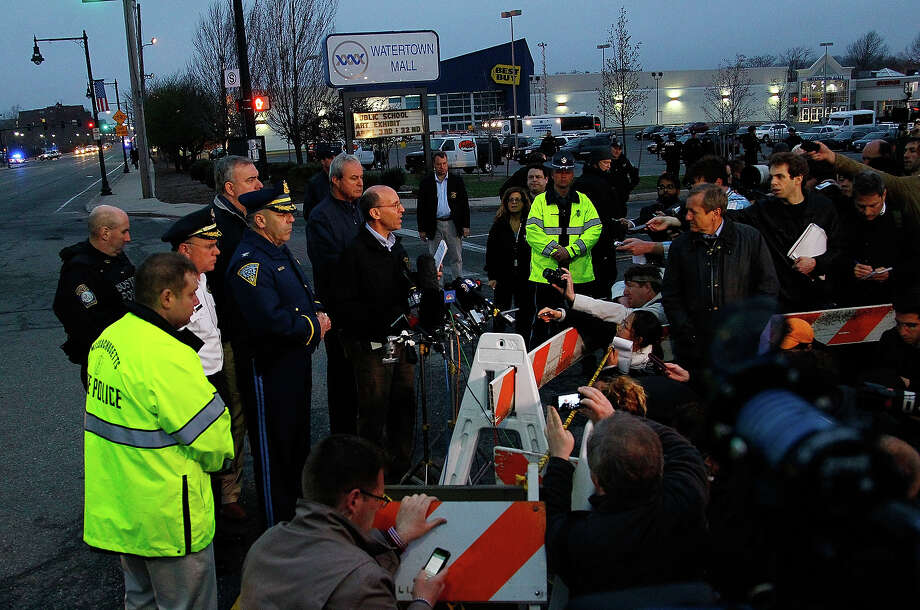 Boston Police Commissioner Edward Davis speaks during a media briefing in the parking lot of the Watertown Mall on April 19, 2013 in Watertown, Massachusetts. Earlier, a Massachusetts Institute of Technology campus police officer was shot and killed late Thursday night at the school's campus in Cambridge. A short time later, police reported exchanging gunfire with alleged carjackers in Watertown, a city near Cambridge. According to reports, one suspect has been killed during a car chase and the police are seeking another - believed to be the same person (known as Suspect Two) wanted in connection with the deadly bombing at the Boston Marathon earlier this week. Police have confirmed that the dead assailant is Suspect One from the recently released marathon bombing photographs. Photo: Jared Wickerham, Getty Images / 2013 Getty Images