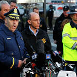 WATERTOWN, MA - APRIL 19: Boston Police Commissioner Edward Davis speaks during a media briefing in the parking lot of the Watertown Mall on April 19, 2013 in Watertown, Massachusetts. Earlier, a Massachusetts Institute of Technology campus police officer was shot and killed late Thursday night at the school's campus in Cambridge. A short time later, police reported exchanging gunfire with alleged carjackers in Watertown, a city near Cambridge. According to reports, one suspect has been killed during a car chase and the police are seeking another - believed to be the same person (known as Suspect Two) wanted in connection with the deadly bombing at the Boston Marathon earlier this week. Police have confirmed that the dead assailant is Suspect One from the recently released marathon bombing photographs.