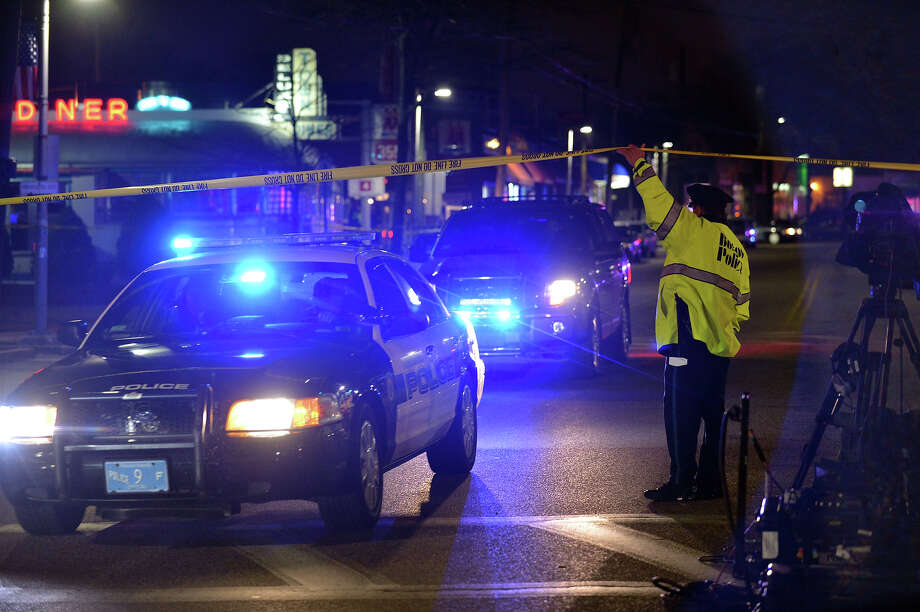 A Boston police officer allows police vehicles out of a closed area as a search for the second of two suspects wanted in the Boston Marathon bombings takes place April 19, 2013 in Watertown, Massachusetts. Police killed one of the suspected Boston marathon bombing suspects in a shootout early today and pursued a chaotic deadly street-to-street manhunt for his accomplice, officials said. 