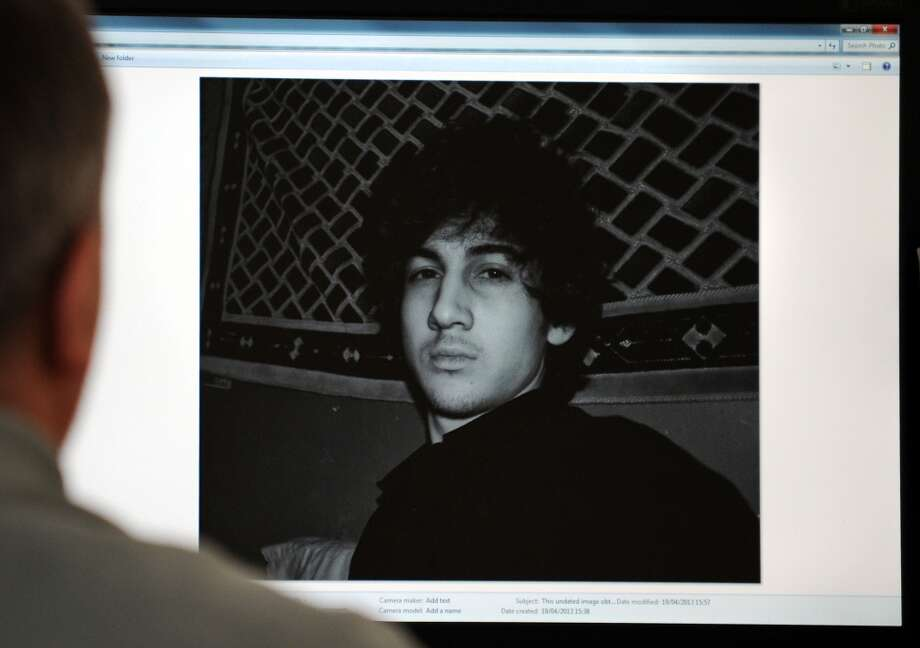 A man looks in Moscow on April 19, 2013, at a computer screen displaying an undated picture the 19-year-old DzhokharTsarnaev posted on his  is page in VKontakte, a Russian social media site. Dzhokhar Tsarnaev is the subject of a April 19, 2013 manhunt in the Boston area. One of the Boston marathon bombing suspects was killed in a shootout early April 19 as police raced on a house-to-house search for the second, with the entire city placed on lockdown. NBC News reported that the two young men believed to be responsible for Monday\'s deadly carnage at the finish line of the prestigious race are brothers of Chechen origin who were permanent legal residents of the United States. AFP PHOTO-/AFP/Getty Images