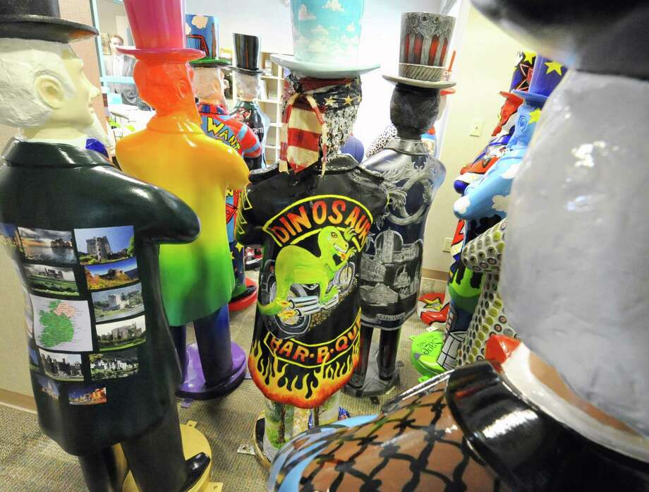 Decorated Uncle Sams wait to be placed around the city of Troy at the BID office Thursday, April 18, 2013 in Troy, N.Y. During Troy Night Out on Friday, April 26th, between 5pm and 9pm, the Uncle Sam Project will be unveiled. (Lori Van Buren / Times Union) Photo: Lori Van Buren