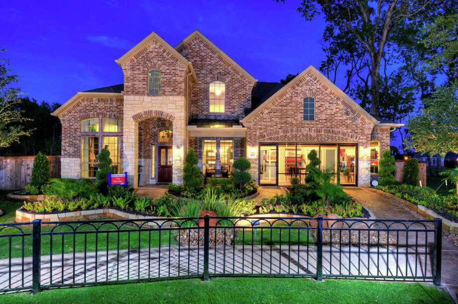 """Summerwood, a wooded community at Sam Houston Parkway northeast and W. Lake Houston Parkway, is giving away free copies of the """"Outdoor Living Idea Book"""" to celebrate the grand opening of its new Model Home Village."""