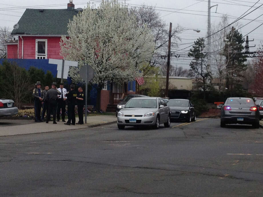 Police in East Norwalk prepare to search an Amtrak train for suspects in the boston marathon explosion. Photo: Contributed / Connecticut Post Contributed