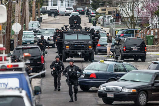 WATERTOWN, MA - APRIL 19: SWAT teams moved into position at the intersection of Nichols Avenue and Melendy Avenue in Watertown while searching for one of the two marathon bombing suspects. Photo: Boston Globe, Getty Images / 2013 - The Boston Globe