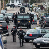 WATERTOWN, MA - APRIL 19: SWAT teams moved into position at the intersection of Nichols Avenue and Melendy Avenue in Watertown while searching for one of the two marathon bombing suspects.