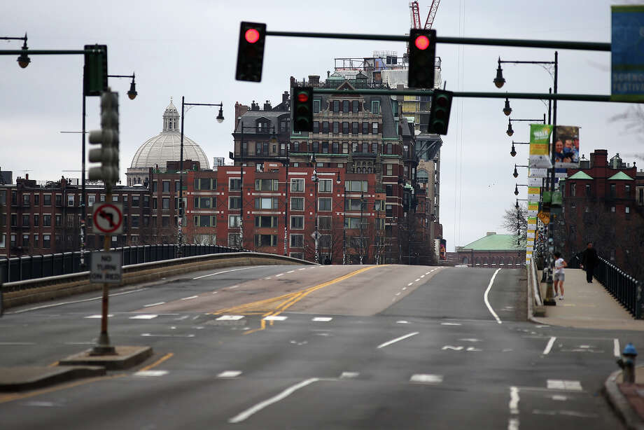 The Boston area is under lockdown as as a manhunt is underway for a suspect in the terrorist bombing of the 117th Boston Marathon earlier this week. The Mass. Avenue bridge has only a few pedestrians crossing. Photo: Boston Globe, Getty Images / 2013 - The Boston Globe