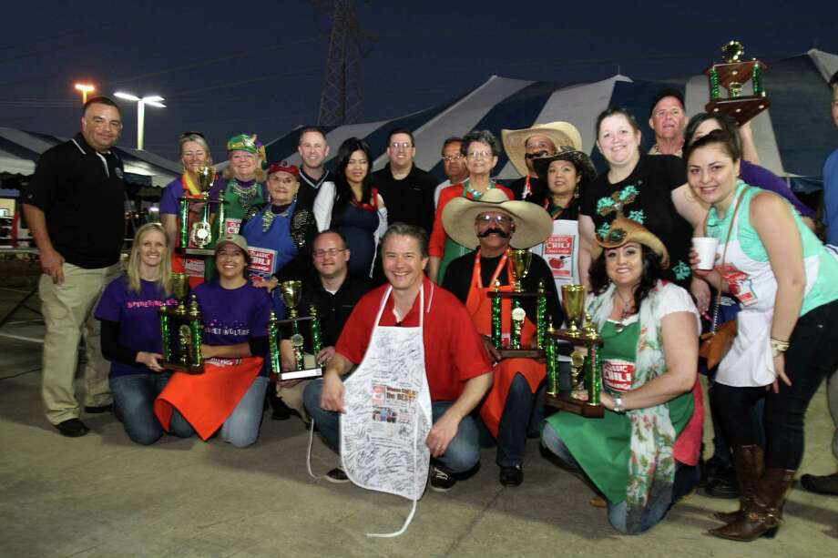 Good sports and good chili is the potent recipe Classic Chevy has been cooking up for its annual Chili Challenge. Led by Don Kerstetter (center, with apron), the Sugar Land dealership has been raising funds for the city's police officers association. Photo: Jeff Yip / (c) Jeff Yip, 2011 All rights reserved