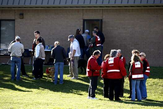Red Cross and volunteers gather outside the West Library Museum. Photo: Johnny Hanson