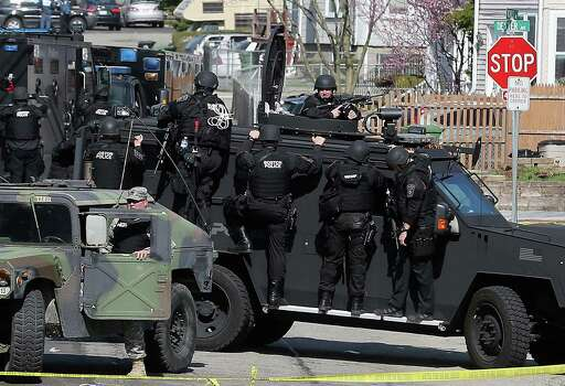 Members of a SWAT team search for 19-year-old bombing suspect Dzhokhar A. Tsarnaev on April 19, 2013 in Watertown, Massachusetts. After a car chase and shoot out with police, one suspect in the Boston Marathon bombing, Tamerlan Tsarnaev, 26, was shot and killed by police early morning April 19, and a manhunt is underway for his brother and second suspect, 19-year-old suspect Dzhokhar A. Tsarnaev. The two men, reportedly Chechen of origin, are suspects in the bombings at the Boston Marathon on April 15, that killed three people and wounded at least 170. Photo: Mario Tama, Getty Images / 2013 Getty Images
