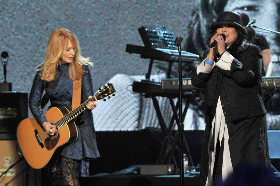 Nancy Wilson (L) and Ann Wilson of Heart perform onstage during the 28th Annual Rock and Roll Hall of Fame Induction Ceremony at Nokia Theatre L.A. Live on April 18, 2013 in Los Angeles.  (Photo by Lester Cohen/WireImage) Photo: Lester Cohen, Getty Images / 2013 Lester Cohen