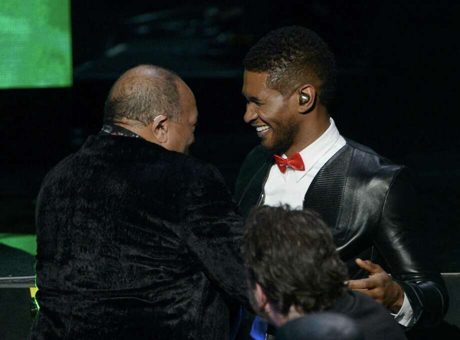 Usher presents inductee Quincy Jones (L) the Ahmet Ertegun Award for Lifetime Achievement on stage at the 28th Annual Rock and Roll Hall of Fame Induction Ceremony at Nokia Theatre L.A. Live on April 18, 2013 in Los Angeles. Photo: Kevin Winter, Getty Images / 2013 Getty Images