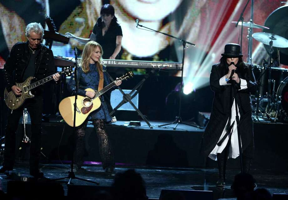 Howard Leese, Nancy Wilson, and Ann Wilson of Heart perform stage at the 28th Annual Rock and Roll Hall of Fame Induction Ceremony at Nokia Theatre L.A. Live on April 18, 2013 in Los Angeles. Photo: Kevin Winter, Getty Images / 2013 Getty Images