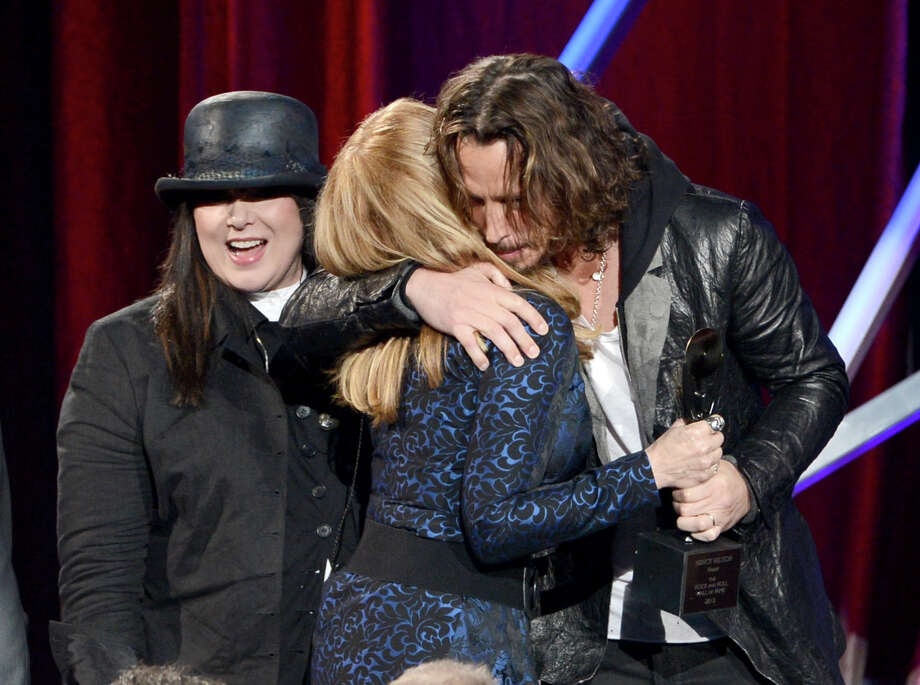 Ann Wilson and Nancy Wilson of Heart and presenter Chris Cornell speak onstage at the 28th Annual Rock and Roll Hall of Fame Induction Ceremony at Nokia Theatre L.A. Live on April 18, 2013 in Los Angeles. Photo: Kevin Winter, Getty Images / 2013 Getty Images