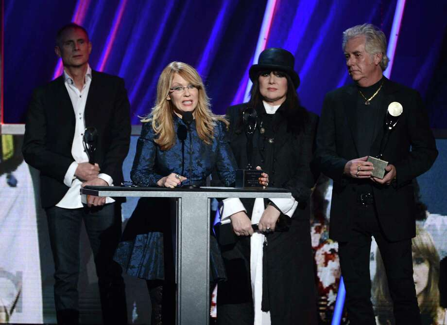 Steve Fossen, Ann Wilson, Nancy Wilson, and Howard Leese of Heart on stage at the 28th Annual Rock and Roll Hall of Fame Induction Ceremony at Nokia Theatre L.A. Live on April 18, 2013 in Los Angeles. Photo: Kevin Winter, Getty Images / 2013 Getty Images