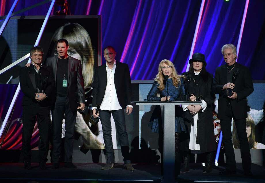 Roger Fisher, Michael DeRosier, Steve Fossen, Nancy Wilson, Ann Wilson and Howard Leese of Heart speak on stage at the 28th Annual Rock and Roll Hall of Fame Induction Ceremony at Nokia Theatre L.A. Live on April 18, 2013 in Los Angeles. Photo: Kevin Winter, Getty Images / 2013 Getty Images
