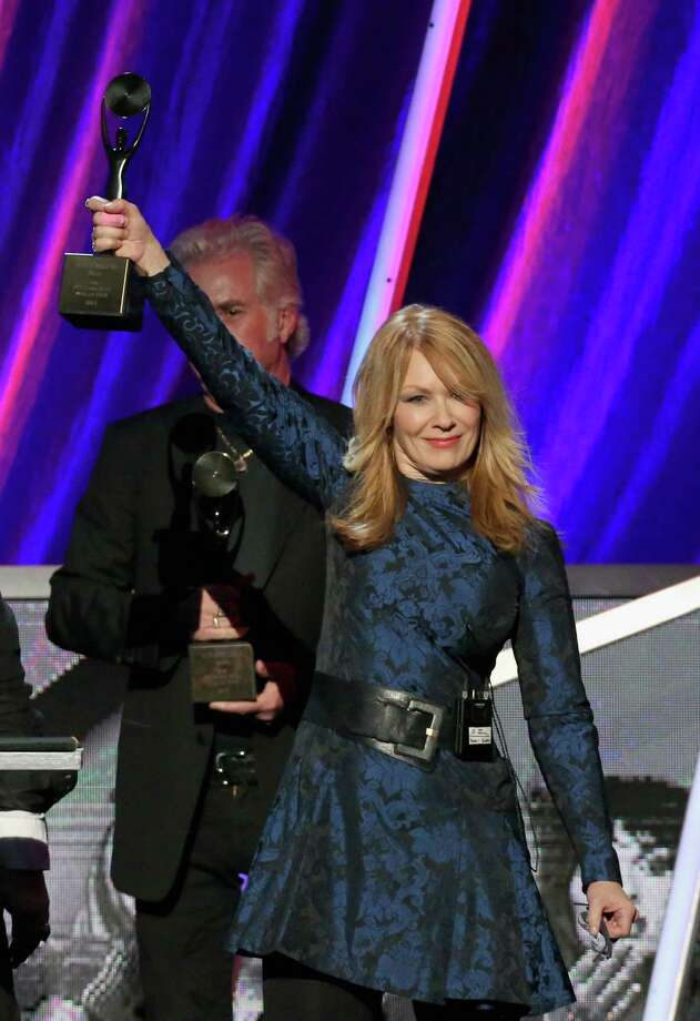 Nancy Wilson of Heart onstage during the 28th Annual Rock and Roll Hall of Fame Induction Ceremony at Nokia Theatre L.A. Live on April 18, 2013 in Los Angeles. (Photo by Kevin Kane/WireImage) Photo: Kevin Kane, Getty Images / 2013 Kevin Kane