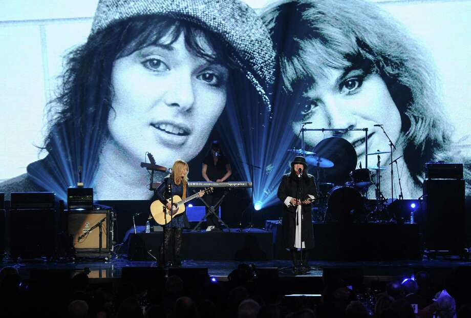 Nancy Wilson and Ann Wilson of Heart perform onstage at the 28th Annual Rock and Roll Hall of Fame Induction Ceremony at Nokia Theatre L.A. Live on April 18, 2013 in Los Angeles. Photo: Kevin Winter, Getty Images / 2013 Getty Images
