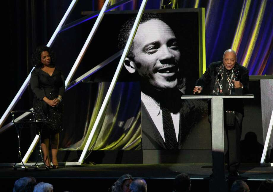 Oprah Winfrey (L) and inductee Quincy Jones speak onstage during the 28th Annual Rock and Roll Hall of Fame Induction Ceremony at Nokia Theatre L.A. Live on April 18, 2013 in Los Angeles. (Photo by Kevin Kane/WireImage) Photo: Kevin Kane, Getty Images / 2013 Kevin Kane