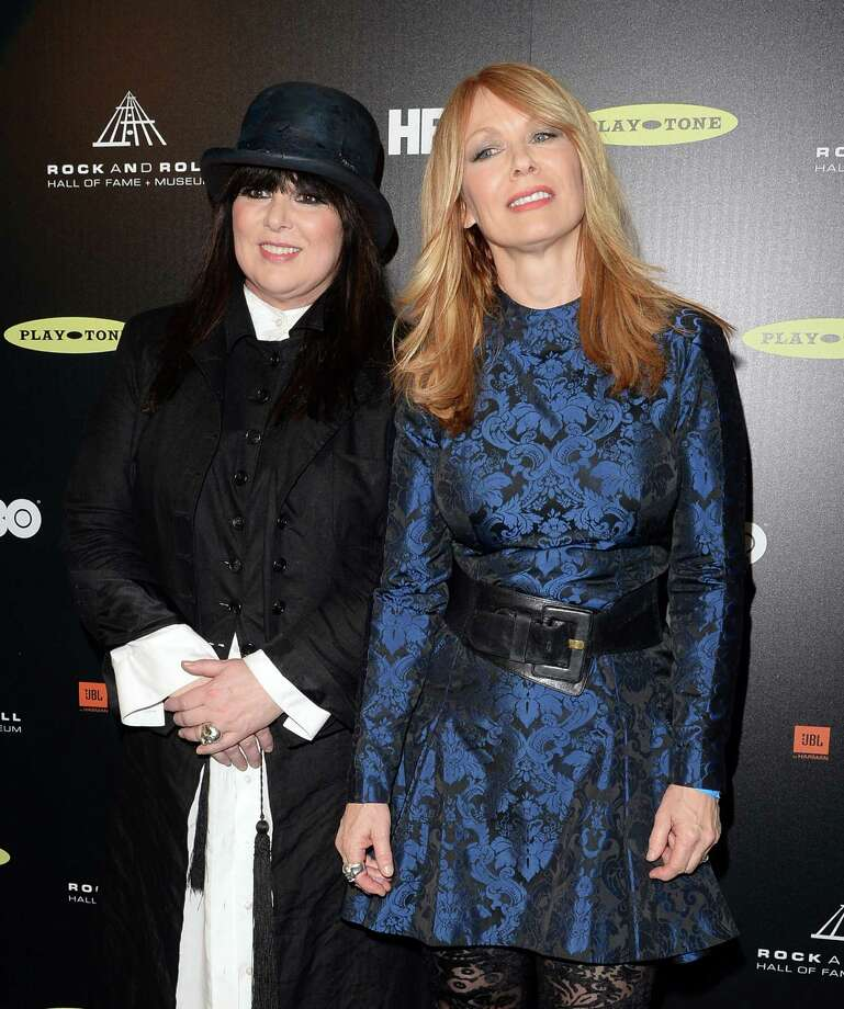 Ann Wilson (L) and Nancy Wilson of Heart pose in the press room at the 28th Annual Rock and Roll Hall of Fame Induction Ceremony at Nokia Theatre L.A. Live on April 18, 2013 in Los Angeles. Photo: Jason Merritt, Getty Images / 2013 Getty Images