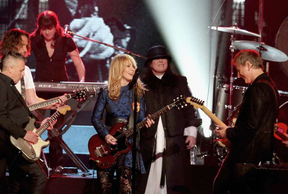 Mike McCready of Pearl Jam, inductees Nancy Wilson and Ann Wilson of Heart, and musician Jerry Cantrell of Alice in Chains perform onstage during the 28th Annual Rock and Roll Hall of Fame Induction Ceremony at Nokia Theatre L.A. Live on April 18, 2013 in Los Angeles.  (Photo by Kevin Kane/WireImage) Photo: Kevin Kane, Getty Images / 2013 Kevin Kane