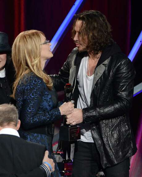 Nancy Wilson of Heart accepts award from presenter Chris Cornell onstage at the 28th Annual Rock and Roll Hall of Fame Induction Ceremony at Nokia Theatre L.A. Live on April 18, 2013 in Los Angeles. Photo: Kevin Winter, Getty Images / 2013 Getty Images
