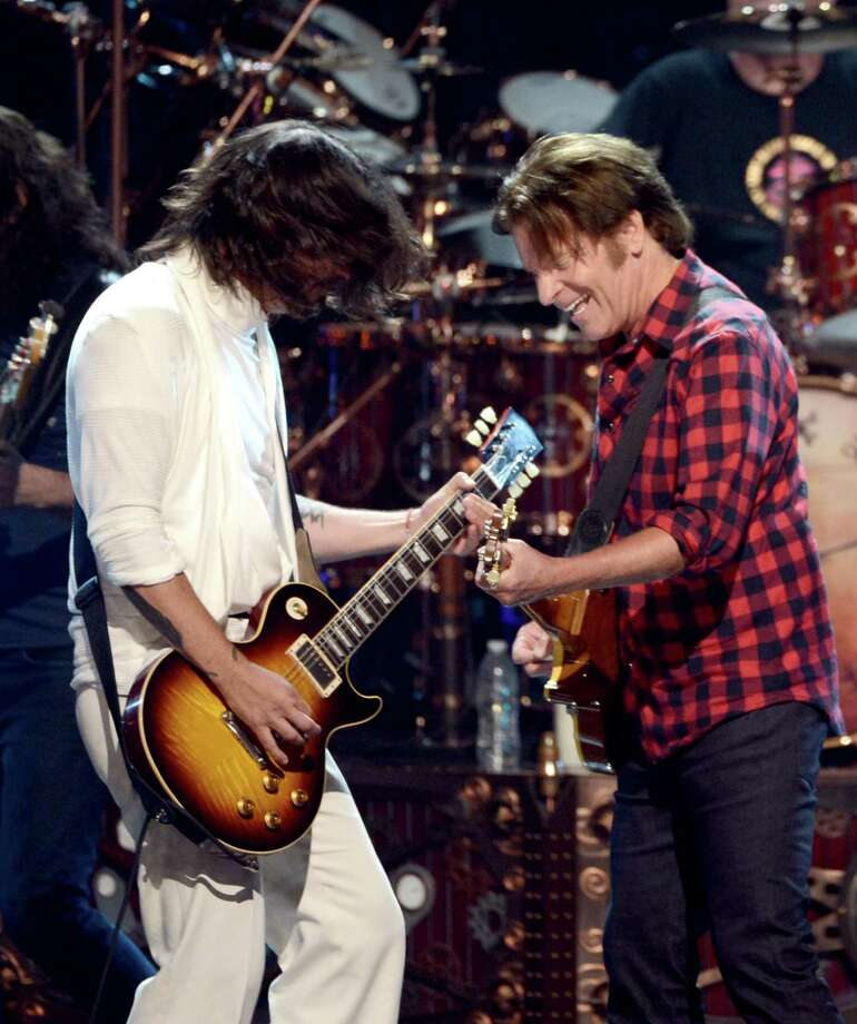 Dave Grohl and John Fogerty of Public Enemy perform onstage at the 28th Annual Rock and Roll Hall of Fame Induction Ceremony at Nokia Theatre L.A. Live on April 18, 2013 in Los Angeles. Photo: Kevin Winter, Getty Images / 2013 Getty Images