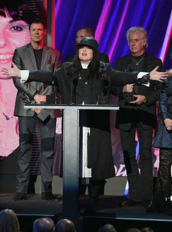 Ann Wilson (C) of Heart speaks onstage during the 28th Annual Rock and Roll Hall of Fame Induction Ceremony at Nokia Theatre L.A. Live on April 18, 2013 in Los Angeles.  (Photo by Kevin Kane/WireImage) Photo: Kevin Kane, Getty Images / 2013 Kevin Kane