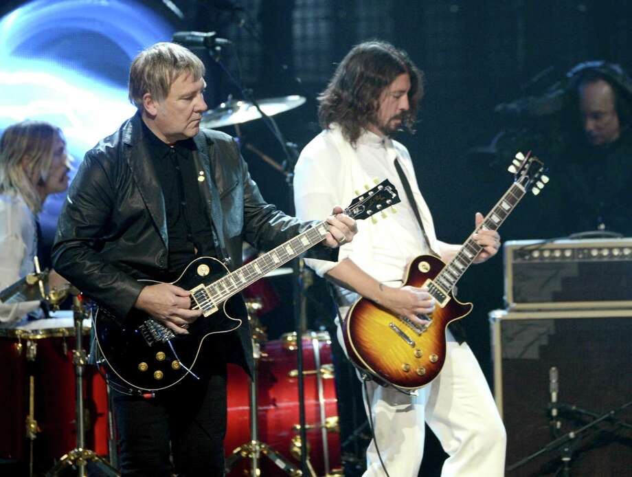 Alex Lifeson of Rush (L) and musician Dave Grohl perform on stage at the 28th Annual Rock and Roll Hall of Fame Induction Ceremony at Nokia Theatre L.A. Live on April 18, 2013 in Los Angeles. Photo: Kevin Winter, Getty Images / 2013 Getty Images